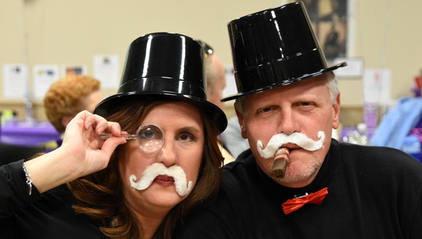 Tina Litteken, David Garver and the rest of their trivia team dressed as Rich Uncle Pennybags, aka the Monopoly man. They said their table's theme was board game night. (All photos by Steve Bowman)
