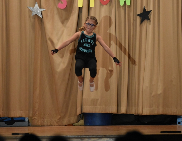 """Above and below, fourth grader Ava Amad dances to """"Stitches"""" by Shawn Mendes."""
