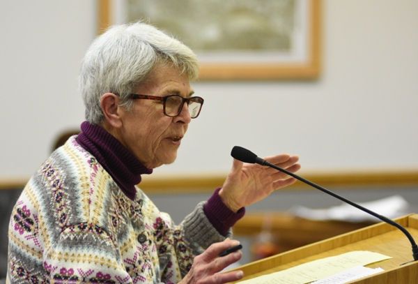 Resident Louise Charboneau speaks during the public hearing portion of the March 7 Board of Aldermen meeting.
