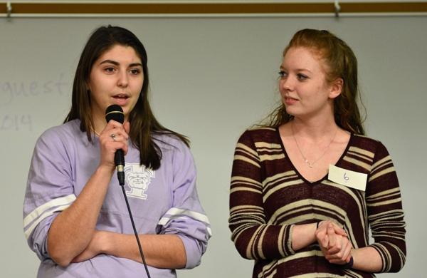 Seniors Megan Shipley (left) and Lindsey Jones take turns at the microphone.