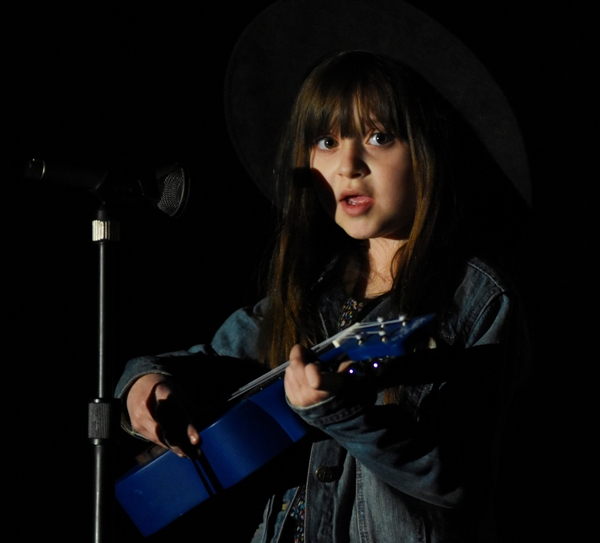 """First grader Charlie Butler accompanies herself on ukulele while singing """"I Live In a Beach House."""""""
