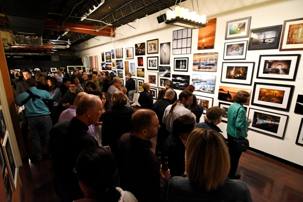 The Seen photo exhibition draws a large crowd on March 10. Viewers voted for their favorites.