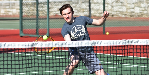 Jesse Laseter charges the net in practice recently at Tilles Park. (All photos by Steve Bowman)