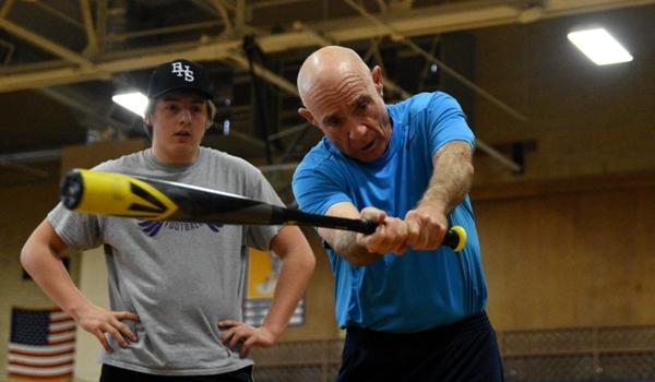 Head coach Mike Imergoot talks to Alex Cobb about hitting technique.
