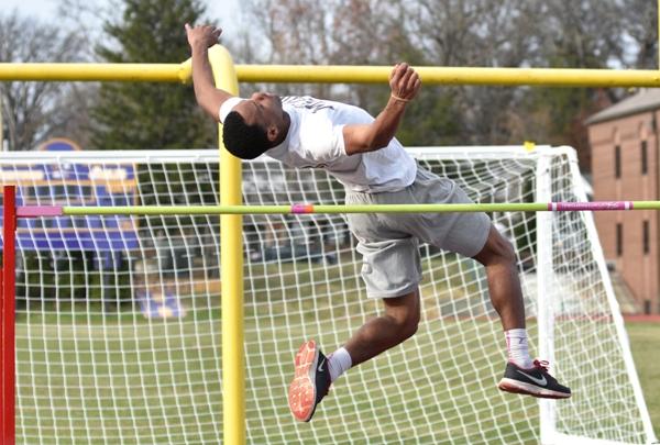 Junior Justice Harris practices the high jump.