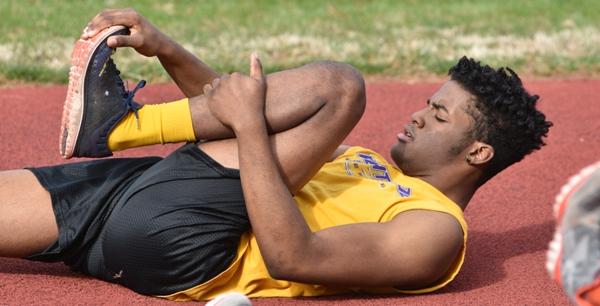 Senior Deshaun Johnson stretches before practice last week. (All photos by Steve Bowman)