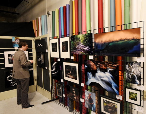 A wide array of backdrops stand behind images in the March 10 photo exhibit.