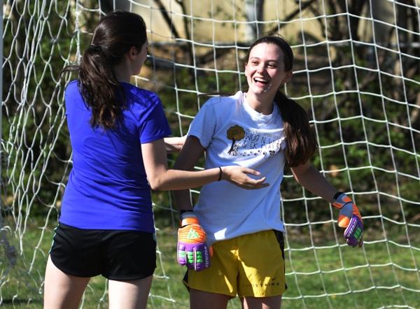 Freshman goalkeeper Logan Darrow laughs at a comment from Amanda Ingersoll.