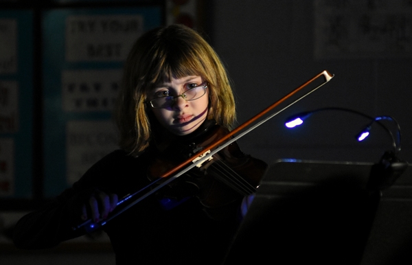 Fourth grader Alex Mayer performs a Star Wars medley in three parts. Playing along with her on violin and piano were kindergartener Charlotte White and fourth graders Avery White and Haven White.