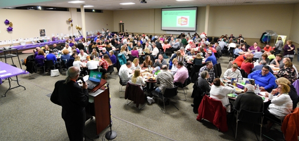 The trivia night attracts 22 eight-person teams to the Brentwood School District Administrative Offices.