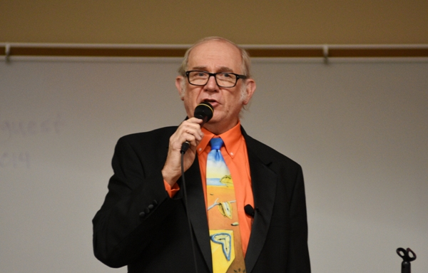 Emcee Ed Wright Jr., a retired BHS teacher, reads a trivia question.