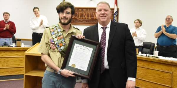 Mayor Chris Thornton hands James O'Halloran a proclamation recognizing his attainment of Eagle Scout. The presentation was made at the March 7 Board of Aldermen meeting at City Hall. (Photo by Steve Bowman)