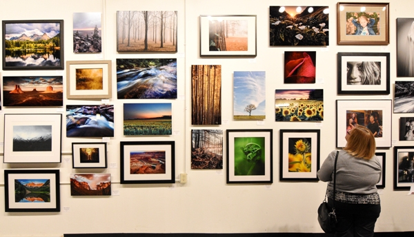A woman views some of the images in the Seen photo contest at Studio Altius on March 10. (All photos by Steve Bowman)