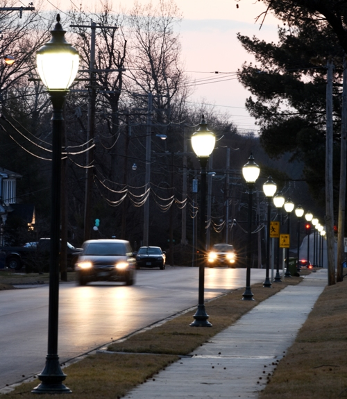 Looking west on Litzsinger Road at our new sidewalk and lamp posts.