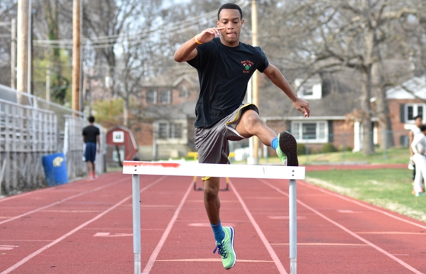 In this photo and the two below, Justin Harris clears a hurdle.