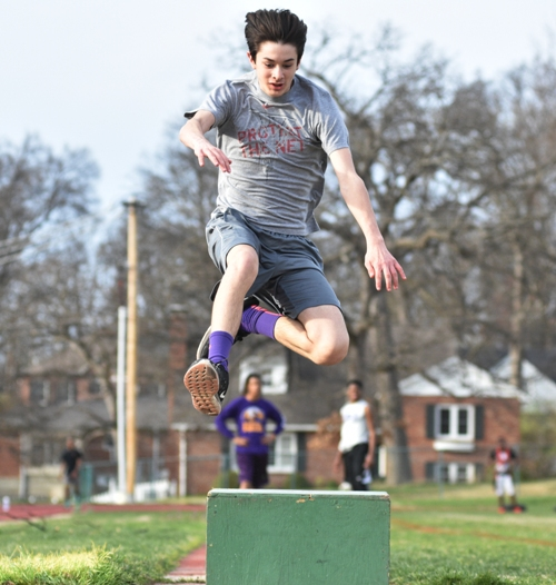 Freshman Billy Flynn practices the long jump.