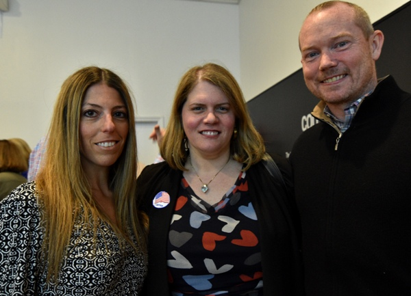 Sunny Sims (center) attends the election watch party with friends Tracy Gellman and Tim Liebe at Core 3 on Tuesday night.