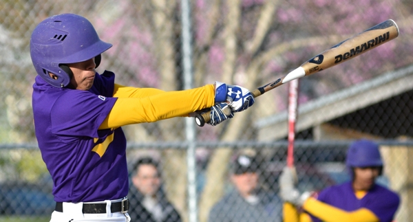 Jonas Heisel swings at a pitch in the fifth inning in the DuBourg game.