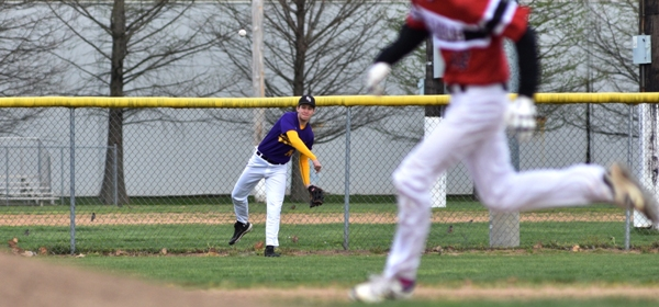 Left fielder Sam Tilton retrieves a single hit by DuBourg in the second inning.