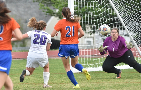 Abby Harper gets the ball past Valley Park goalkeeper Alyssa Haines to make it 3-0 in the first half.