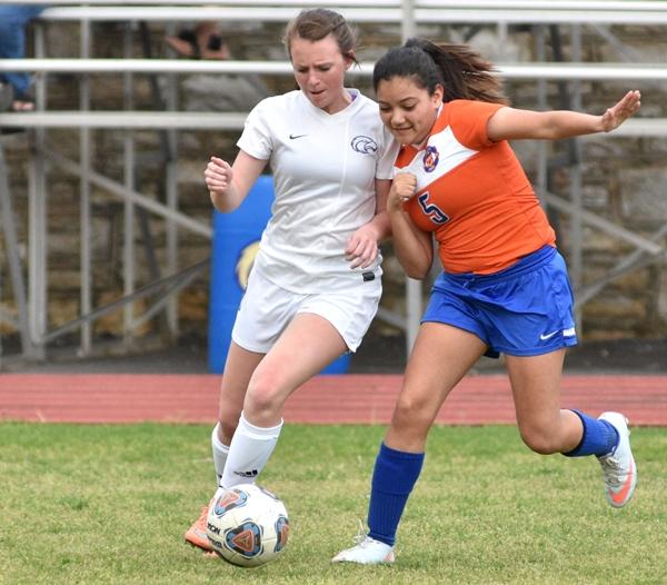 Maddie Dorenbusch dribbles against Valley Park's Jane Doe.