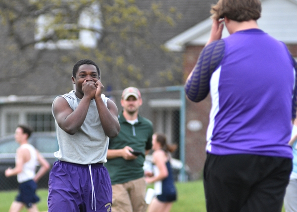 Tayveon Brown laughs about beating teammate Michael Doebber's (right) previous javelin throw. The two took turns holding the lead until Brown finally won the event.