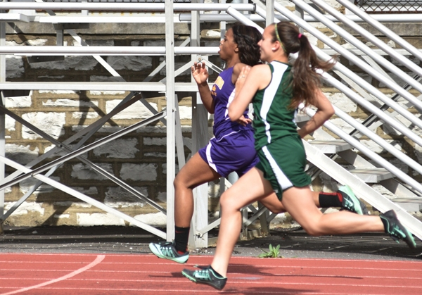 Nyiah Thompson stays just ahead of a Bayless runner in the 200.