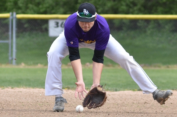 Mike Mills scoops up a grounder against Bishop DuBourg.