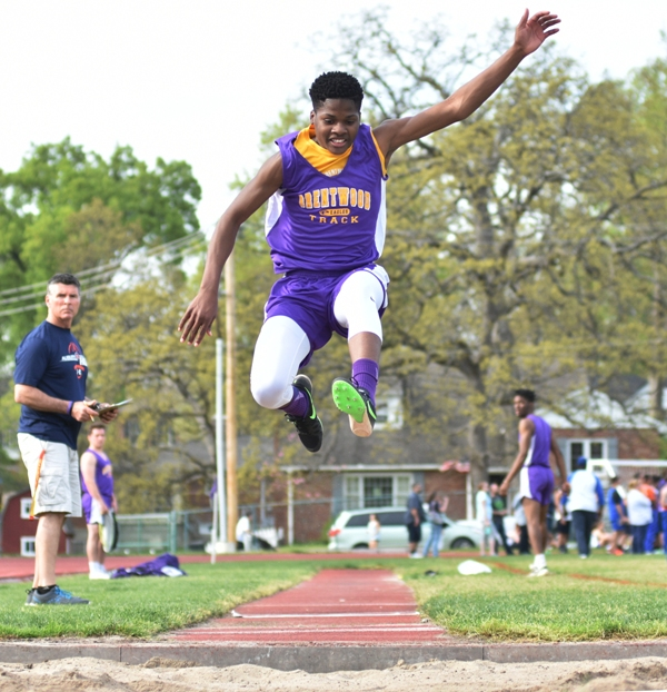 Courtland Hill in the long jump.