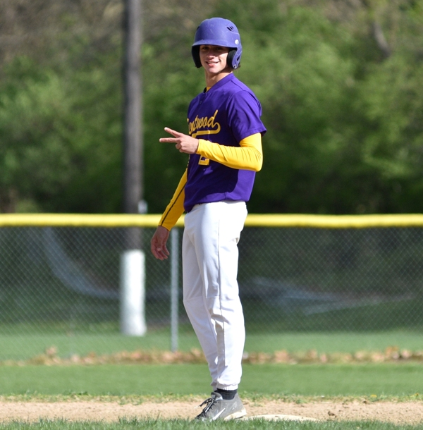 Joe Clay smiles about reaching second base safely in the second inning against DuBourg.