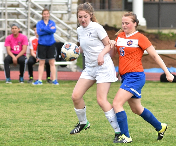 Mackenzie Baum (left) tries to get control of the ball against.