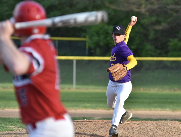 Joe Clay pitches the final inning against DuBourg.