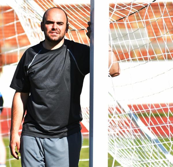 Assistant coach Brian Wildgrube plays goalkeeper in practice.