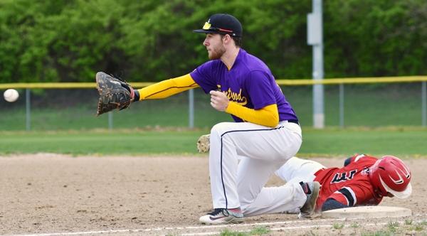 Morgan Murphy receives a throw from pitcher John Bischoff at first base.