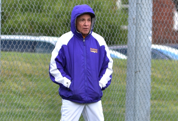 Mike Imergoot coaches third base in the DuBourg game, where temperatures reached the 40s.