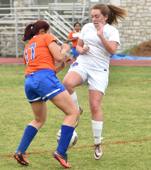 Abby Harper (right) finds an obstacle in Valley Park's Eva Gonzalez.