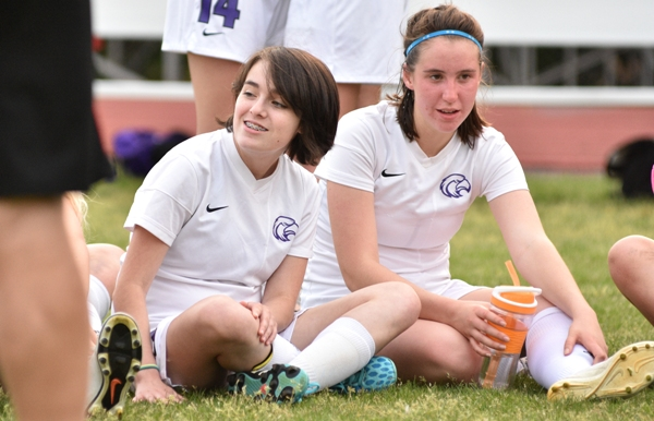 Caroline Bender (left) and Gabby Gombas rest during halftime of the Valley Park game.