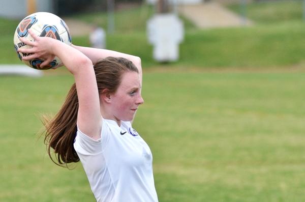 Maddie Dorenbusch puts the ball back in play.