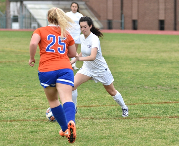 In the photos above and below, Amanda Ingersoll suddenly cuts left to get the ball past Valley Park's Lexie Waldman.