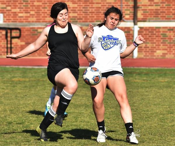 Freshman defender Meghan Haug (left) and sweeper Maggie Callihan.