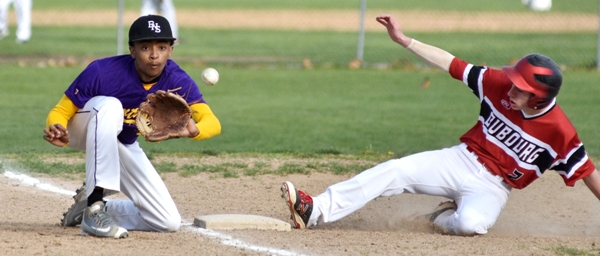 The throw is late to Butters Jones as a Bishop DuBourg runner reaches third base in the fourth inning.