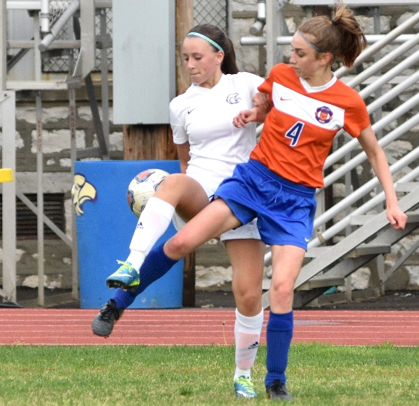Elle Curran (left) gets tangled with Julia Cwiklowski of Valley Park.