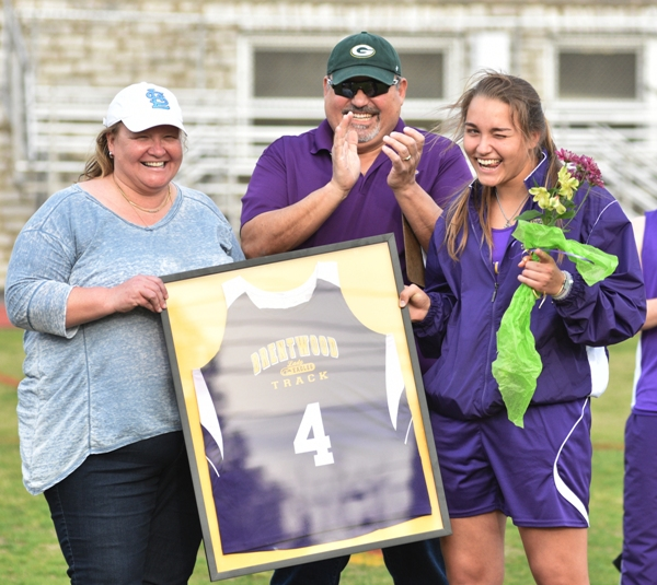 """During a """"senior night"""" ceremony midway through the Brentwood Invitational, it was announced that Sophia Rivera's jersey would be retired and hung in the school. She stands with her parents Edwin Rivera and Michelle Hassemer."""