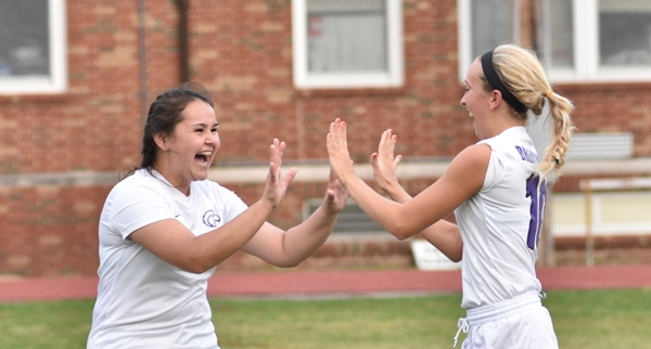 Maggie Callihan (left) celebrates with Kate Gilmore after Gilmore's goal makes it 4-0 against Valley on April 20 at Brentwood High School. (All photos by Steve Bowman)