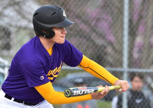 Sam Tilton prepares to bunt in the second inning against DuBourg.