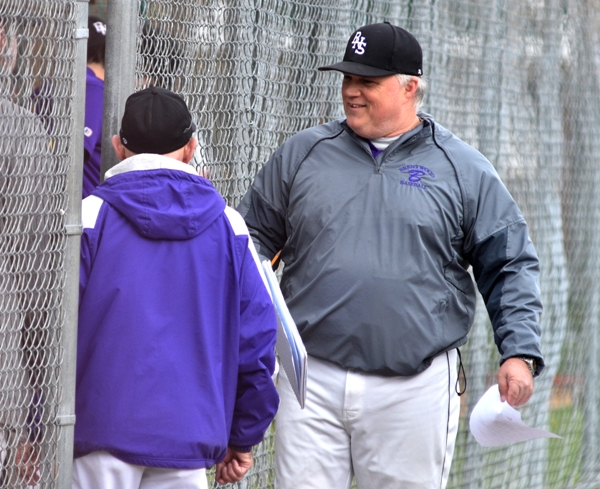 Assistant coach John Sappington chats with Mike Imergoot before the DuBourg game.