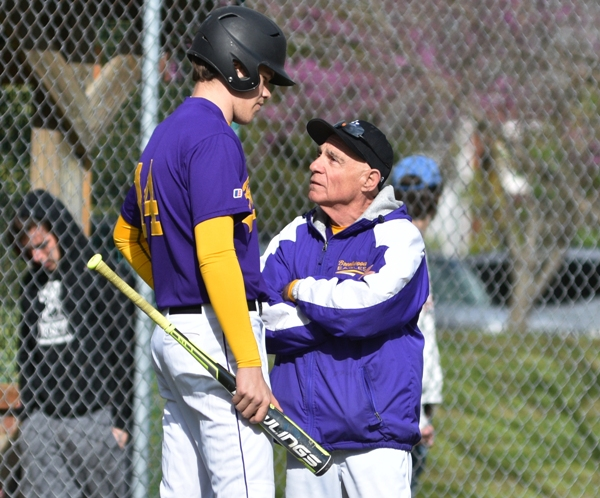Brentwood head coach Mike Imergoot talks to Sam Tilton before he bats in the second inning vs. DuBourg.