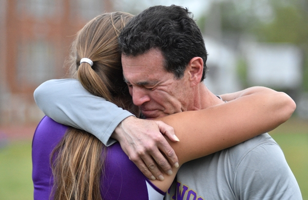 Rivera hugs an emotional Ron Eichaker, her throwing coach since she was 12.