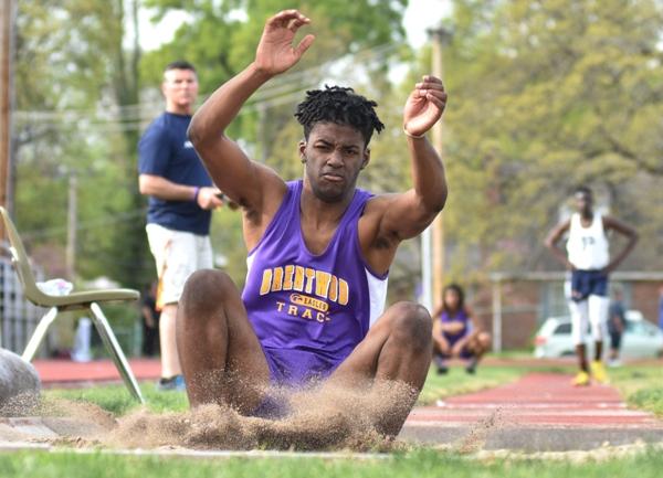 Deshaun Johnson lands in the long jump pit.