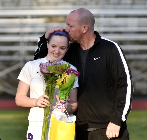 Torri Brotherton gets a kiss from her father, Bob.